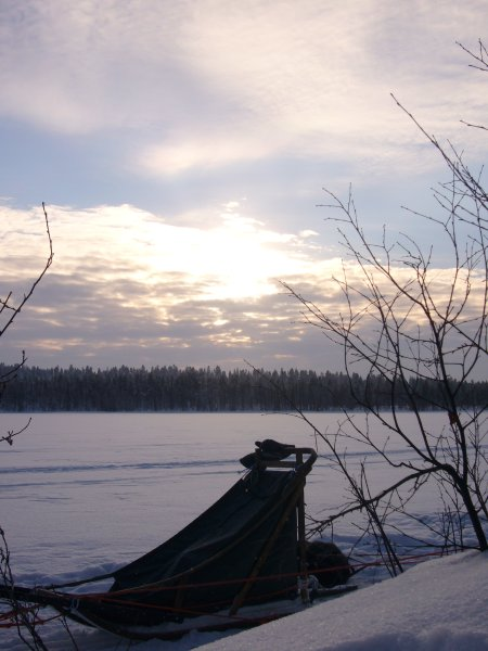 Sled by lake